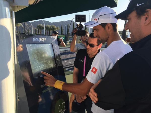 Novak Djokovic engaging with PlaySight kiosk