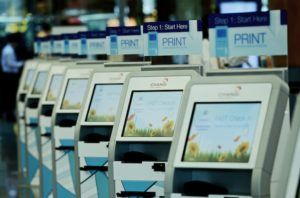 ST11082015-1522337892/ kasia12/ Matthias Ho SIA is rolling out a whole slew of self-check in kiosks at the departure counters in Changi Airport T2. Passengers can process their own boarding through the kiosks and proceed to counters to drop off their baggage. Other services like amending personal details and choosing of seats are also available on the kiosk system. // Photo by Matthias Ho for The Straits Times