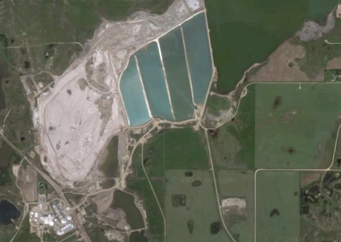 An aerial view of tailing ponds (top middle) at PotashCorp's Patience Lake, Saskatchewan mine. Source: Google Maps