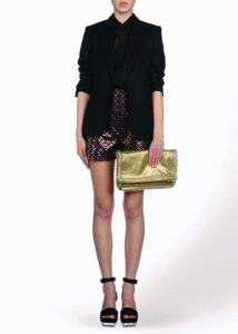 Sustainable Black Jacket – Black shirt in silk / Paper – Short in organic cotton/ Plexi – Black Shoes/ Gold Falabela in faux leather
