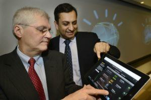 Exhibit 2: Dr. Mark Kris (MSK) and Manoj Saxena (IBM) looking onto 2013 version of Watson for Oncology app