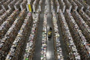 Image #: 25648312 A worker gathers items for delivery from the warehouse floor at Amazon's distribution center in Phoenix, Arizona November 22, 2013. The web-based retailer is preparing for Cyber Monday, which is traditionally the busiest day of the year for online purchases, and falls on December 2 in 2013. REUTERS/Ralph D. Freso (UNITED STATES - Tags: BUSINESS TPX IMAGES OF THE DAY EMPLOYMENT) REUTERS /RALPH D. FRESO /LANDOV