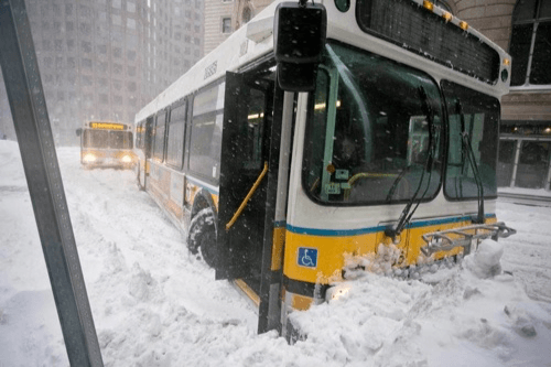 An MBTA bus struggles through the snow Source: Boston Globe