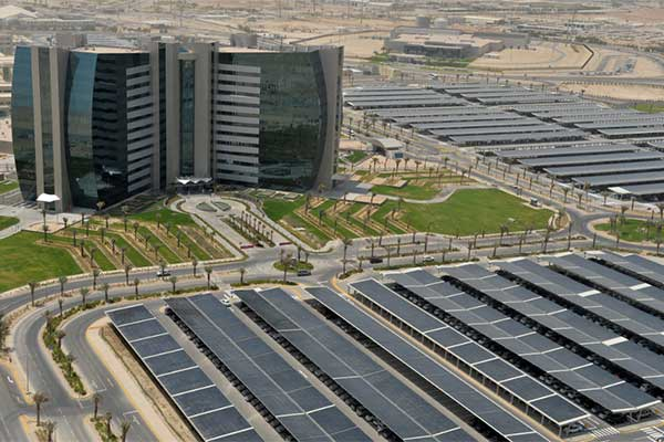 An Aramco office building in Saudi Arabia integrates solar panels in the shaded parking lot