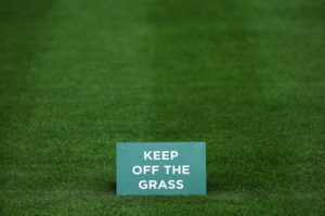 LONDON, ENGLAND - JUNE 22: A General View of a 'keep of the grass' sign seen on a one of the courts during previews for Wimbledon Championships at Wimbledon on June 22, 2014 in London, England. (Photo by Steve Bardens/Getty Images)