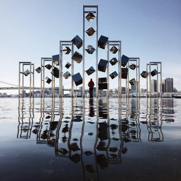 Man standing between floating cubes