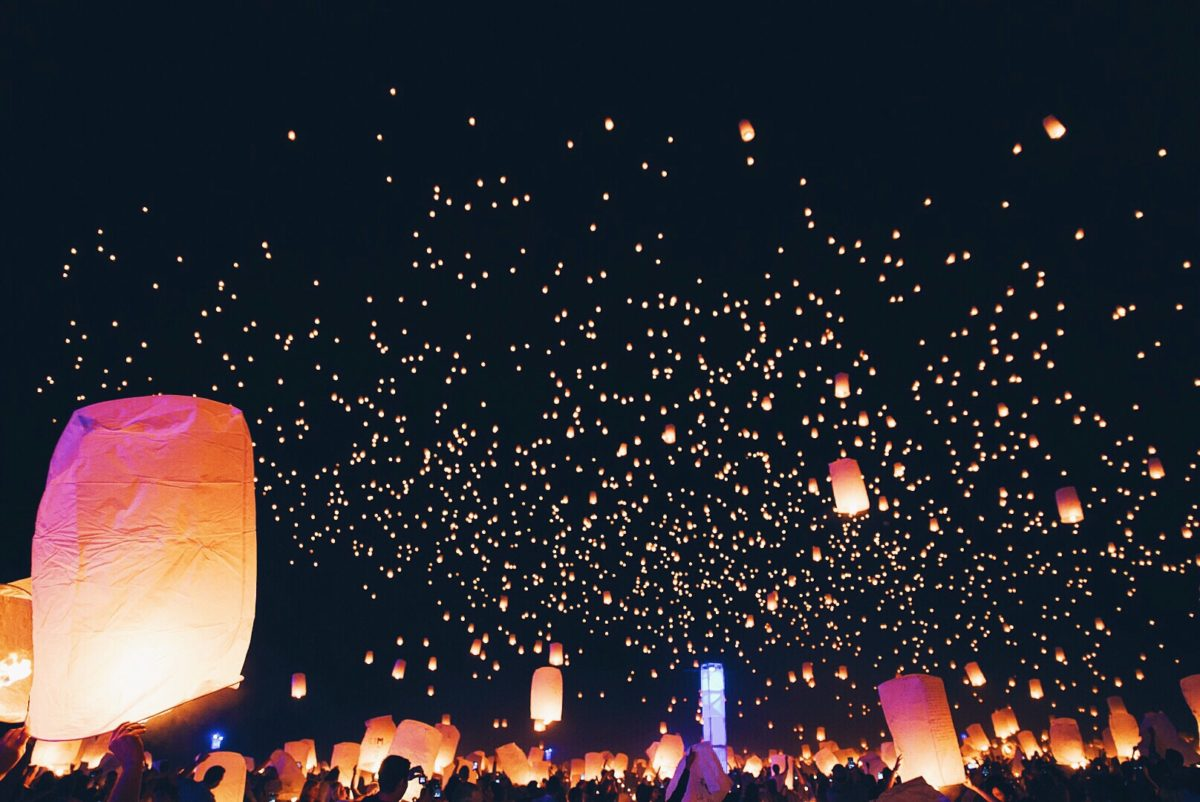 Colored lanterns rising into night sky