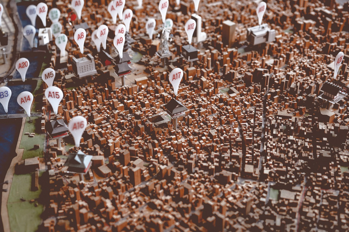 Raised map of a city with pins