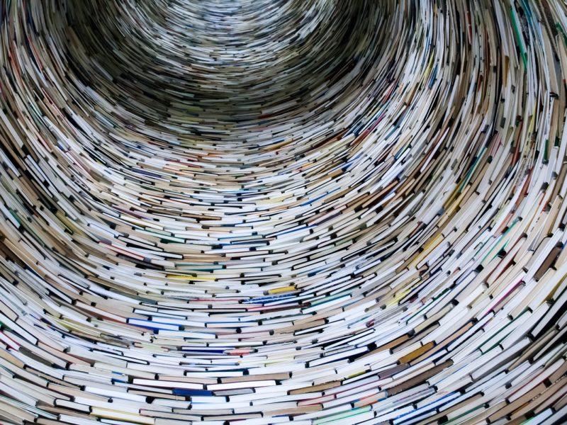 Books in a tornado like tower_unsplash