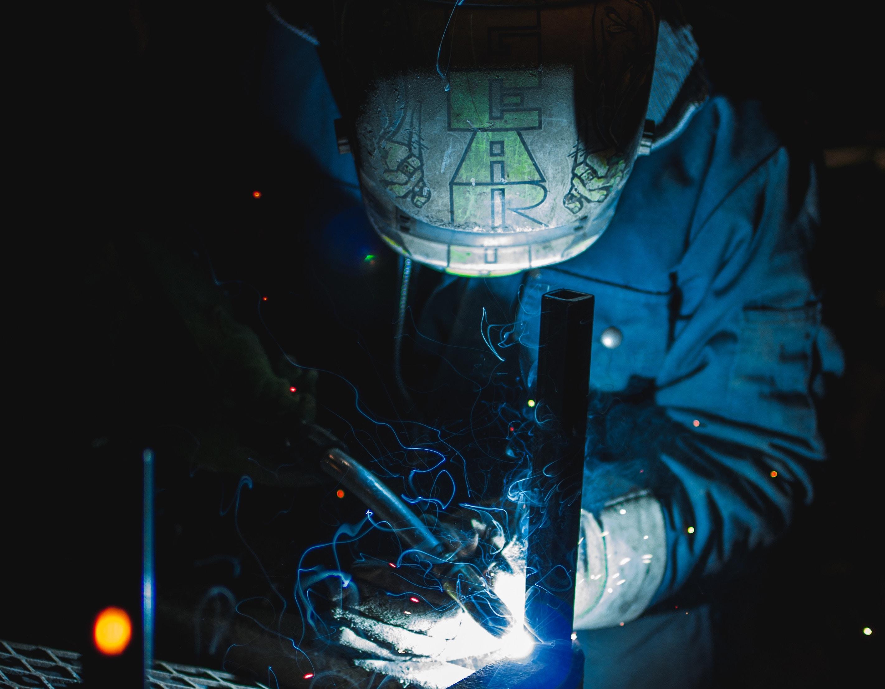 Industrial setting man soldering