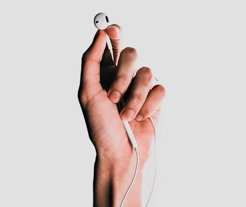 Hand holding earbuds
