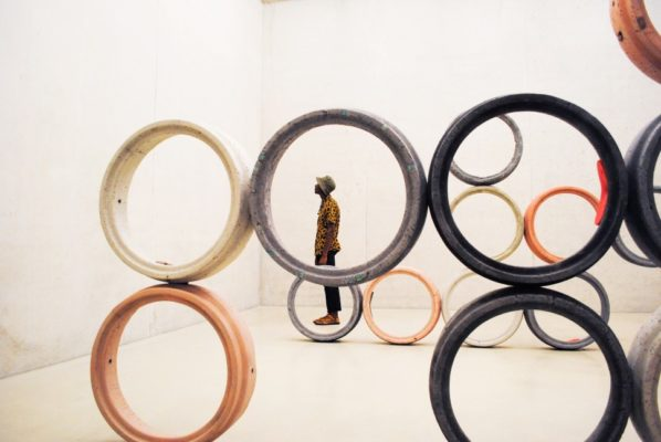 Man in art museum surrounded by circles