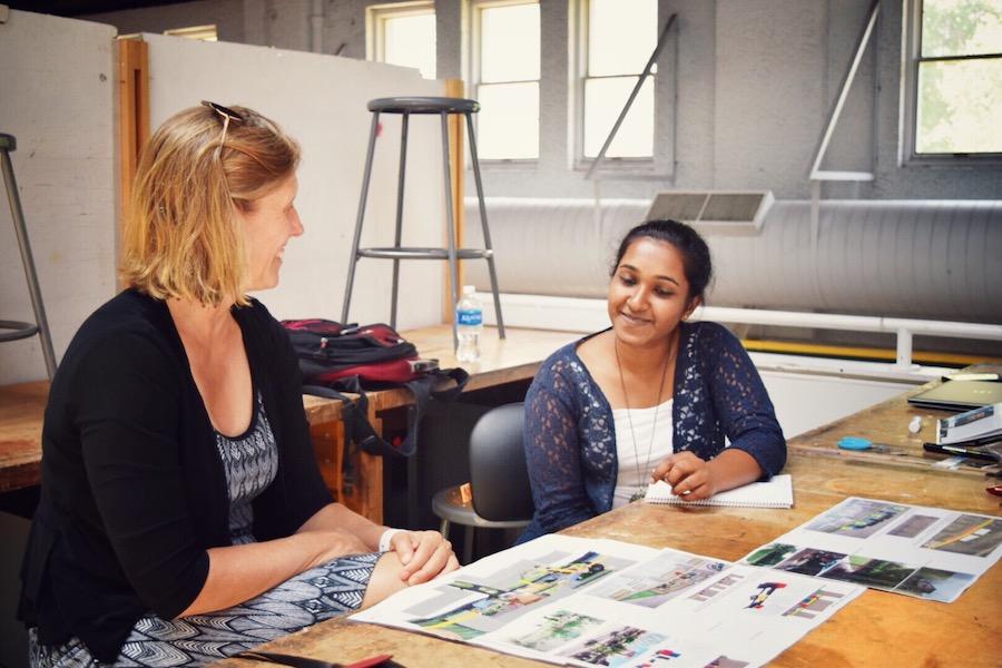 Women looking at design studio prints