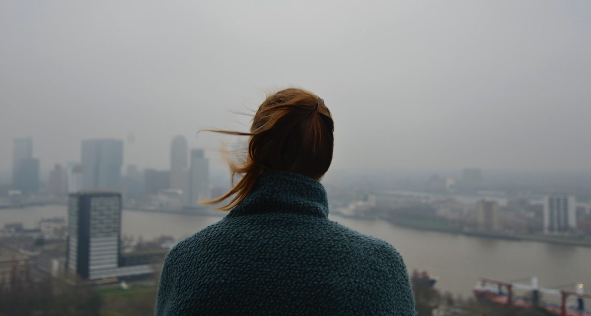 woman overlooking a city in smog