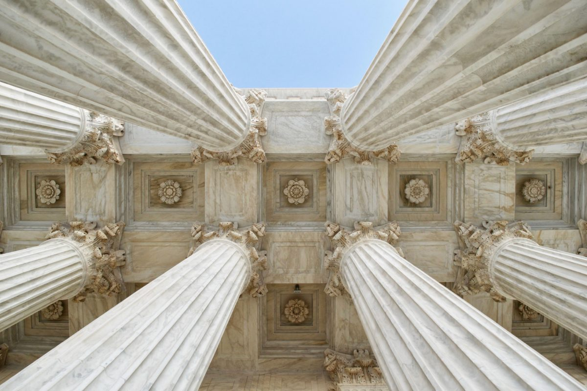 Upward view of government building columns